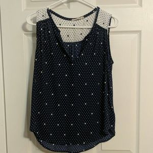 Sleeveless blue and white polkadot top